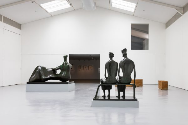 Installation view with Henry Moore, King and Queen 1952-53 bronze (LH 350), Reclining Figure: Hand 1979 bronze (LH 709) and Edmund de Waal, tacet X and XI, Hornton stone, 2020.